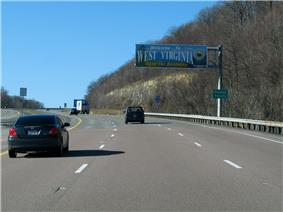 A sign above the highway reads