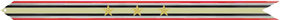 A multicolored streamer with (from outer to inner) red, white, green, white again, black (the colors of the Iraqi flag) horizontal stripes with a yellow horizontal stripe in the center