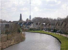 Hollandse IJssel through IJsselstein with church and Gerbrandy Tower in background