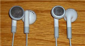Two early designs of Apple earbuds.