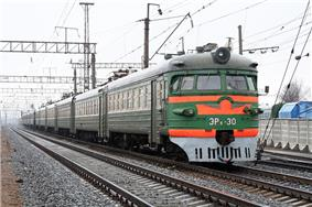 Green-and-orange electrified train