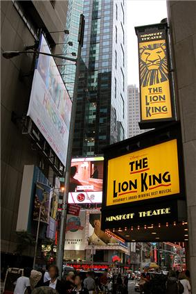 The façade of Minskoff Theatre at Broadway, with banners promoting the Lion King musical.