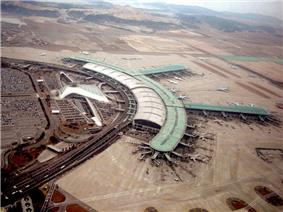 Tilted aerial view of modern airport. Aircraft are parked next to