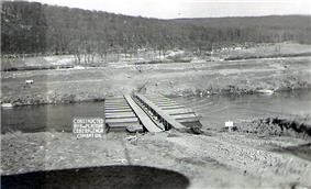 Infantry support bridge over Saar River erected by 289th Engineers at Volklingen.jpg