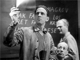 Ingmar Bergman examining a negative