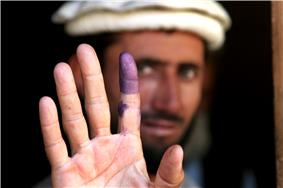 Purple ink on an Afghan voter's finger