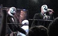 Adult males in black-and-white face paint