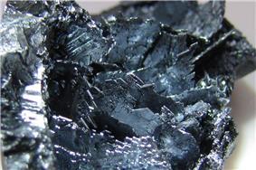 Shiny violet-black coloured crystalline shards.