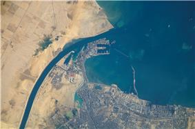 Satellite view of the port and city that are the southern terminus of the Suez Canal that transits through Egypt and debouches into the Mediterranean Sea near Port Said. (Up is north-east).