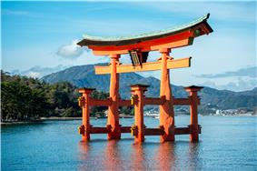 The torii of Itsukushima Shrine, the site's most recognizable landmark, appears to float in the water.