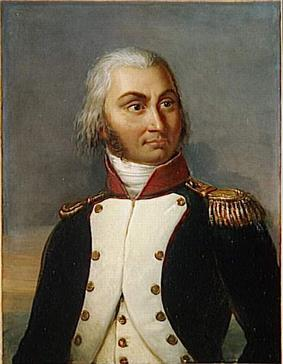 Formal half portrait of Jourdan in dress military uniform, wearing a dark coat with white lapels, a red shoulder sash and gold waist sash. He has golden epaulets on his shoulders. He is an older man with gray hair pulled into a pony-tail, a fair face and a long nose.