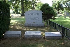 Three Robinson family gravestones are placed next to a larger family headstone with the quotation
