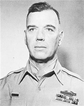Head-and-shoulders photo of General James Van Fleet, 60-year-old white man shown wearing khaki uniform blouse, four-star insignia and neckerchief.