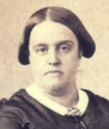 Sepia photograph showing the head and shoulders of a middle-aged woman wearing a dark dress with thin white collar