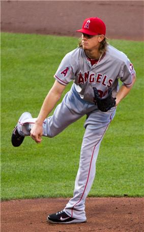 Jered Weaver, wearing a red baseball cap and grey baseball uniform with the words ANGELS across and an