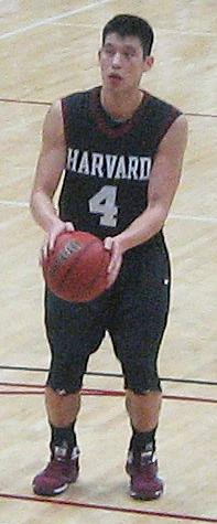 Lin wearing a crimson colored Harvard basketball jersey