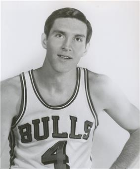 A man wearing a basketball jersey with