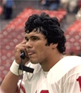 A picture of Jim Plunkett on a phone.