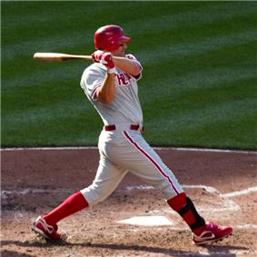 Thome has swung through a pitch during a day game wearing his gray Phillies uniform.