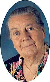 photo portrait of Johanna Budwig, an elderly lady with gray hair and a floral dress