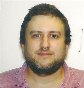 face front head shot of Smolin who has a beard