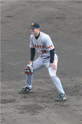 A baseball player standing on the infield