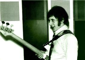 John Entwistle backstage with a bass guitar