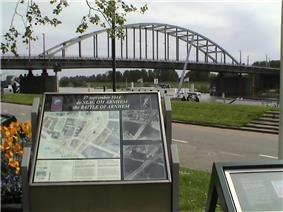 Colour picture of memorial with the bridge in the background
