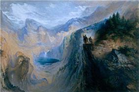 Two men stand on a cliff overlooking a valley surrounded by forests and tall mountains.
