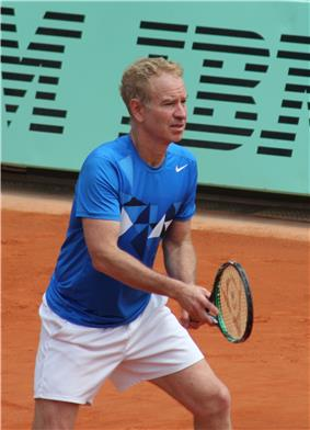 McEnroe won 9 titles in the year