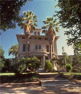 Photograph of the Victorian John Muir House from street level, looking up at the house and its pergola against the sky.