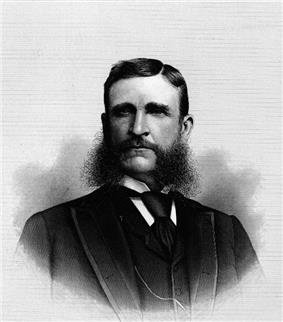 Upper-body portrait of a late-nineteenth-century man in a suit.