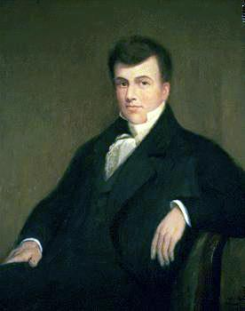 Upper-body portrait of a mid-nineteenth-century man in a suit and sitting down