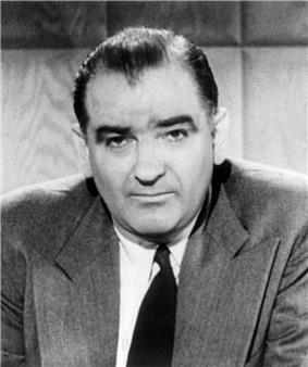 Portrait of a man in a suit.