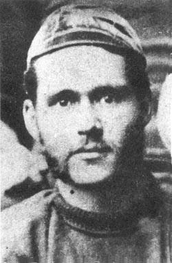 A man wearing an old-fashioned rugby cap