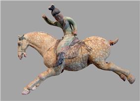 A ceramic female polo player