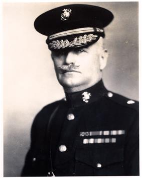 A black and white image of John Myers, a white male in his Marine Corps dress blue uniform. He has a moustache, is wearing a hat and several ribbons are visible.