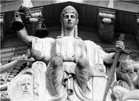 A statue of Justice on the tympanum of the Old Supreme Court Building, Singapore