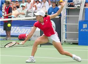 Justine Henin won two Grand Slam titles to finish at number one for the second straight season.