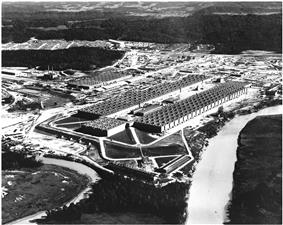 Oblique aerial view of an enormous U-shaped building.