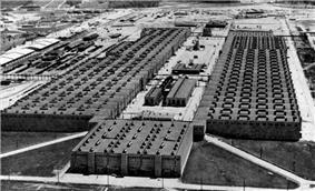 Oblique aerial view of an enormous U-shaped building.