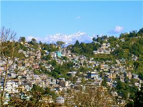 Kalimpong town as viewed from a distant hill. In the background are the Himalayan Mountains.