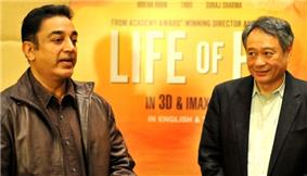 Ang Lee, a gray-haired man, looking at Haasan (who is speaking)