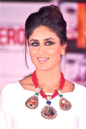 Kareena Kapoor smiling away from the camera