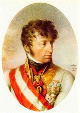Oval painting of a cleft-chinned young man with wavy brown hair and sideburns. He wears a white military coat with a wide red and white sash over the shoulder.