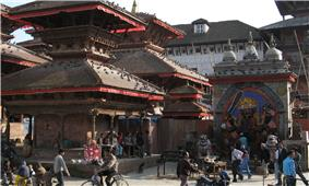 Streetscene with various characteristically shaped temple buildings.