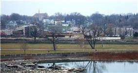 Kaukauna's south side downtown, as seen from the Statue Park on the North Side.  The Fox River is in the foreground and the Civic Center is on the far right.