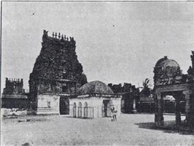 courtyard of a temple with towers in the background