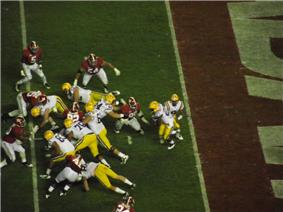 American football players running a running play.