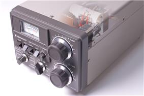 Gray cabinet front panel with knobs, meter and switches